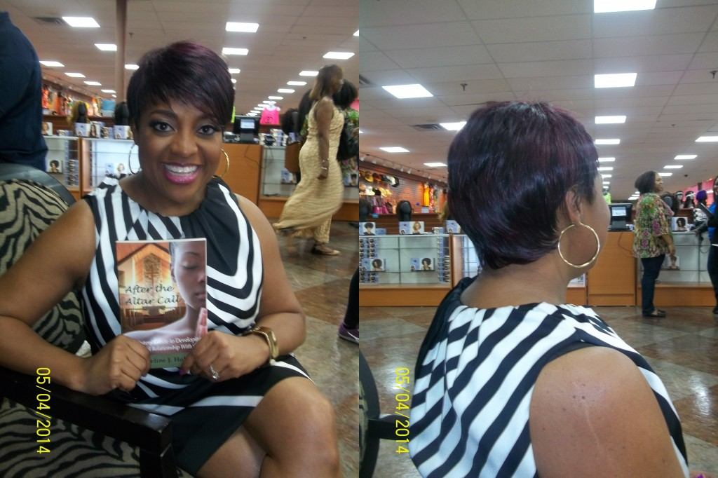 Sherri (who is holding a copy of my book) shows off her Sleek Angle wig from the front and the back...