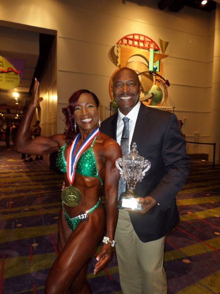 First-Place Women's Physique Winner Linda Bolton of Newnan with Eight-Time Mr. Olympia Lee Haney Photo credit: Shandra Hill Smith